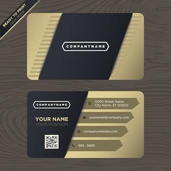 Preto e projeto do cartão de visita do ouro