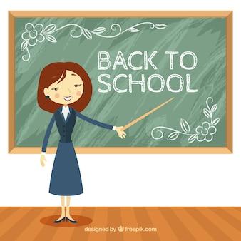 Professor em sala de aula com quadro-negro atrás