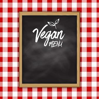 Projeto do menu do quadro-negro Vegan em um fundo pano riscado