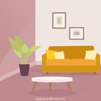 Sala de estar com sofá e planta