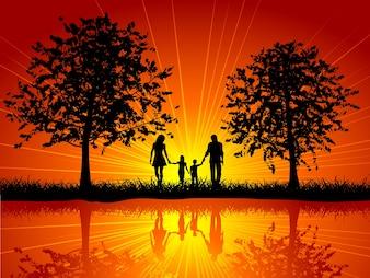 Silhueta de uma família caminhando para fora sob as árvores