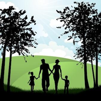 Silhueta de uma família que anda fora no campo