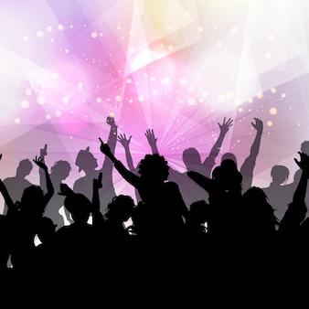 Silhueta de uma multidão do partido sobre um fundo luzes de discoteca