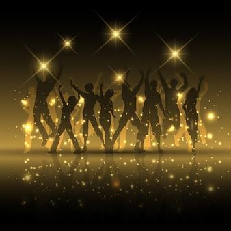 Silhuetas de pessoas dançando em um fundo abstrato luzes