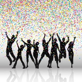 Silhuetas de pessoas dançando em um fundo colorido confetti