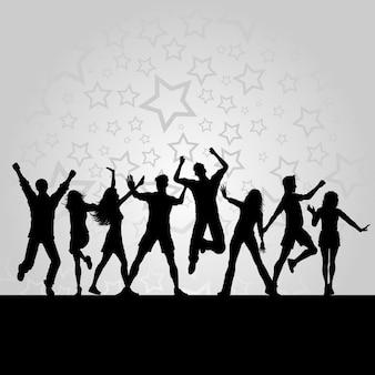 Silhuetas de pessoas dançando em um fundo estrelado