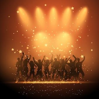Silhuetas de pessoas do partido que dançam em um fundo estrelado