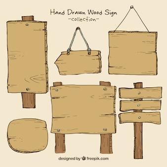 Sinais de madeira com pregos embalar
