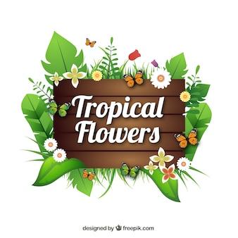Sinal de madeira com flores e folhas