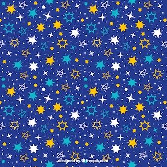 Teste padrão azul escuro com variedade de estrelas desenhados à mão