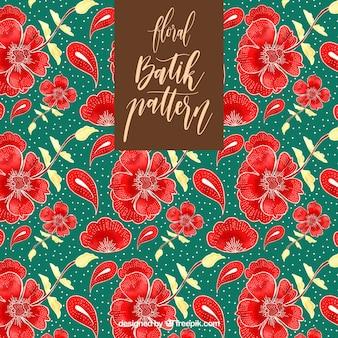 Teste padrão do Batik com flores vermelhas desenhados à mão