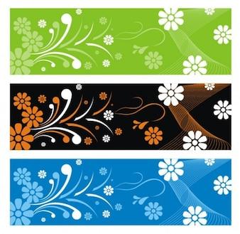 Três banners com elementos florais