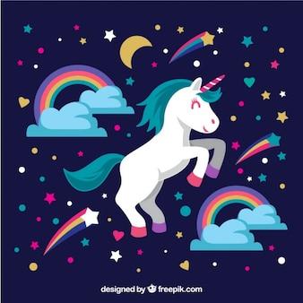Unicórnio bonito com arco-íris e estrelas