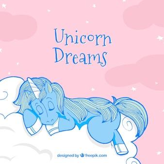 Unicornio desenhado a mão dormindo em um fundo de nuvem