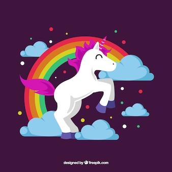 Unicórnio feliz e arco íris com design plano