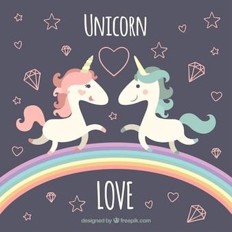 Unicórnios bonitos no arco-íris