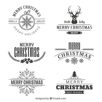 Vários emblemas vintage do Feliz Natal