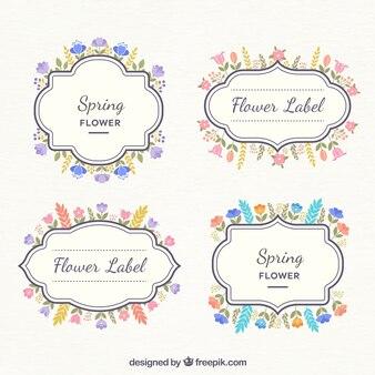 Vários rótulos decorativos com flores coloridas