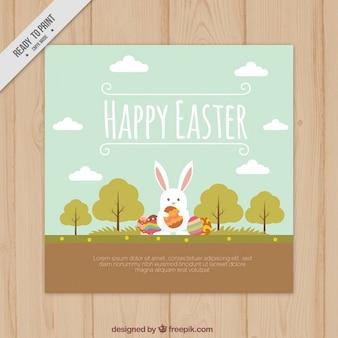 A mano coniglio disegnato in una scheda di Pasqua paesaggio