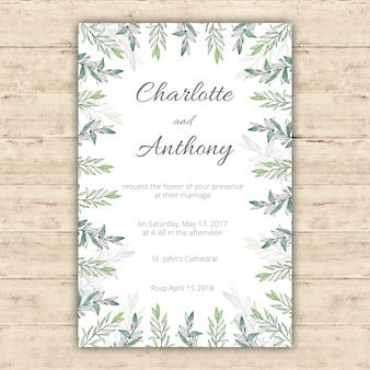 Acquerello modello di invito a nozze con foglie verdi