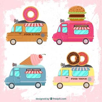 Autocarri alimentari con ciambelle, hamburger e gelati