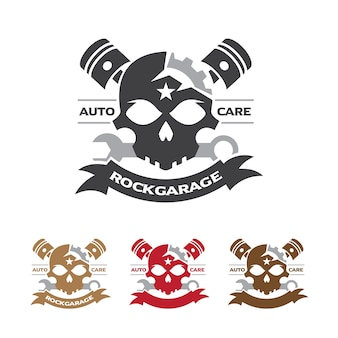 Badge del motociclo del cranio con la chiave e il simbolo del pistone.