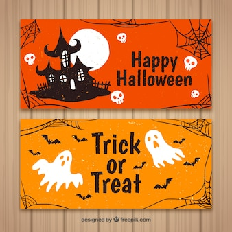 Banner di Halloween con la casa e fantasmi
