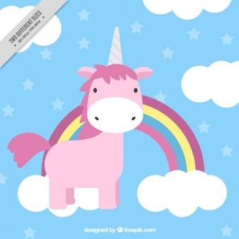 Bella disegnata a mano unicorno rosa con arcobaleno e nuvole