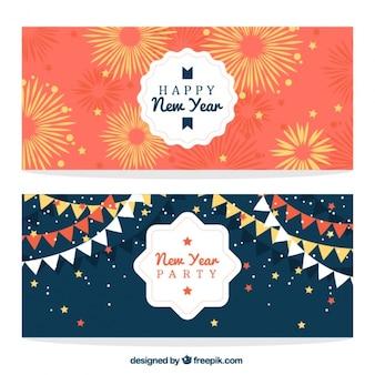 Belle nuovi banner anno con fuochi d'artificio e ghirlande
