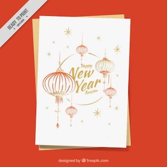 Biglietto di auguri con le lanterne per l'anno gallo