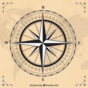 Bussola con sfondo mappa del mondo