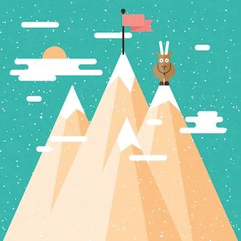 Capra su una montagna di neve