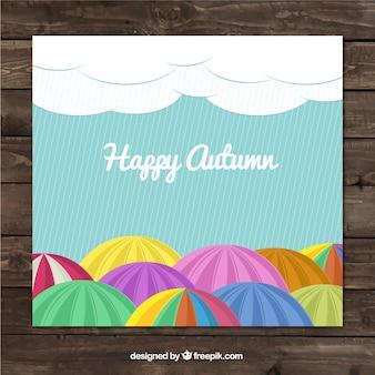 Carta autunno Felice con ombrelloni colorati