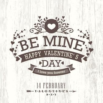 Carta del giorno di San Valentino con floreale annata bandiera del segno su fondo in legno