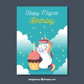 Cartolina di compleanno blu con un unicorno felice