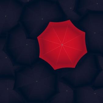 Concetto di ombrello rosso in piedi fuori dalla nera