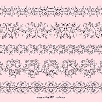 Confezione di bordi floreali disegnati a mano