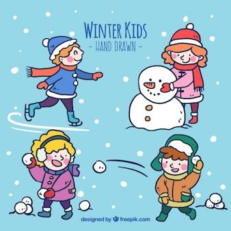 Confezione di mano disegnato bambini a giocare con la neve
