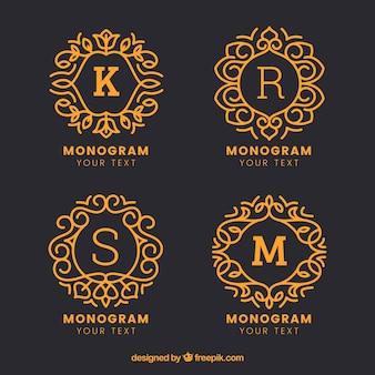 Confezione di monogrammi disegnati a mano d'oro