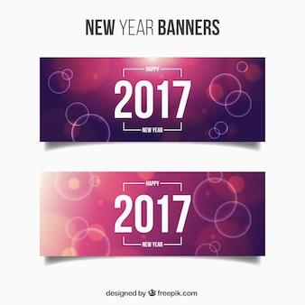 Confezione di nuovi banner anno con sfondi viola e cerchi luminosi