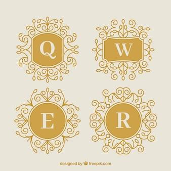 Confezione di quattro monogrammi decorativi d'oro