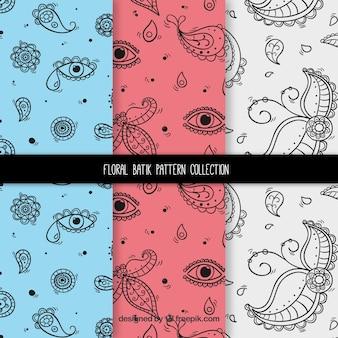 Disegni disegnati a mano in batik con elementi ornamentali