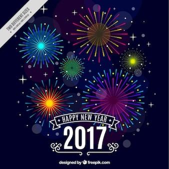 Felice anno nuovo sfondo con fuochi d'artificio colorati