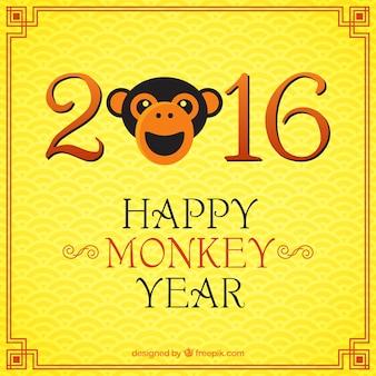 Felice anno scimmia su uno sfondo giallo