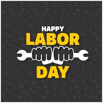 Felice festa del lavoro Tipografia creativa con la chiave e dei lavoratori le mani su un pattern di sfondo nero