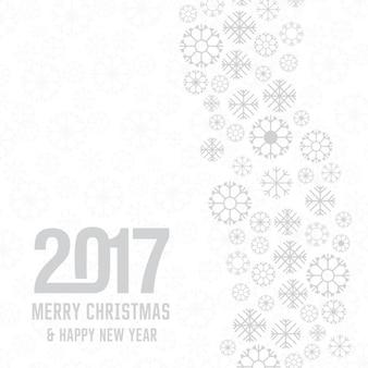 Fiocco di neve Buon Natale 2017 e Capodanno scritta su sfondo bianco vacanze