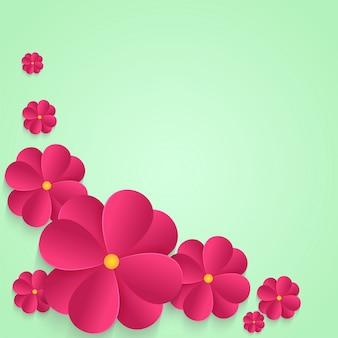 Fiori di carta rosa su sfondo astratto.