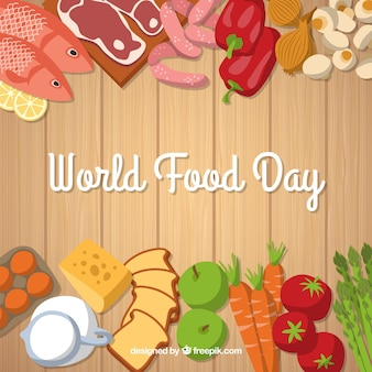 Giornata mondiale di cibo su fondo in legno