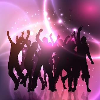 Gruppo di persone che ballano su astratto luci sfondo