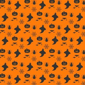 Halloween motivo floreale arancione senza saldatura. Sfondo senza fine con zucche, teschi, pipistrelli, ragni, fantasmi, ossa, caramelle, ragnatele